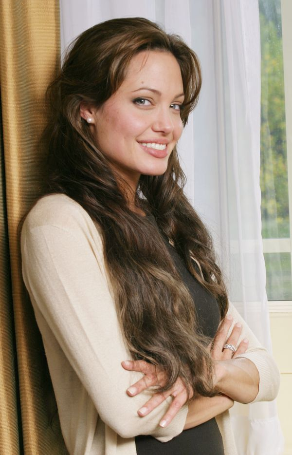 LONDON - OCTOBER 12:  ***NO U.S. SALES FOR 90 DAYS***  ***U.S. TABLOIDS OUT***  Actress Angelina Jolie poses backstage at a p