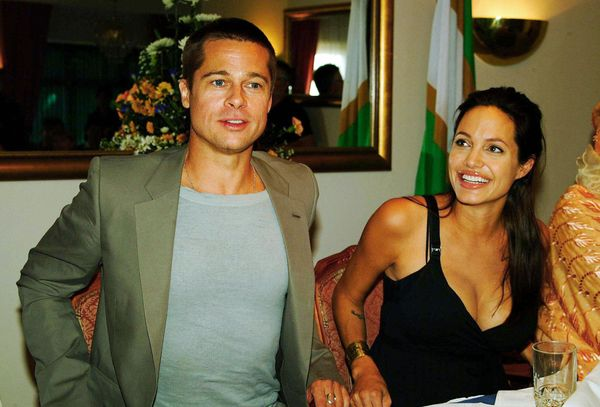 Swakopmund, NAMIBIA:  Hollywood couple Angelina Jolie (R) and Brad Pitt give a press conference 07 June 2006, at a Swakopmund