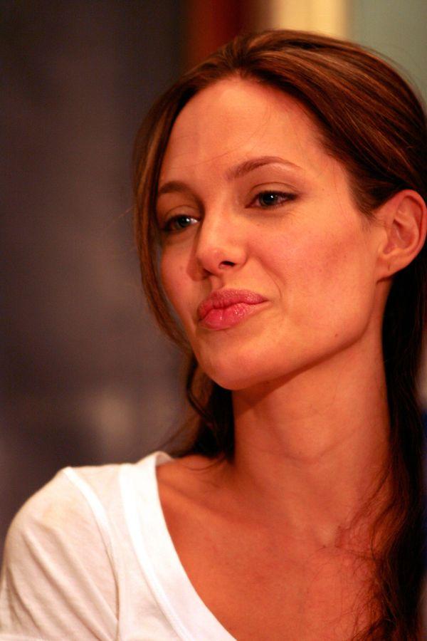 INDIA - NOVEMBER 16:  Angelina Jolie, American actress, sitting in the princess room at the Taj Mahal Hotel in Colaba, Mumbai