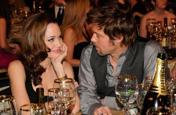 SANTA MONICA, CA - JANUARY 07:  Actors Angelina Jolie (L) and Brad Pitt inside at the 13th ANNUAL CRITICS' CHOICE AWARDS at t