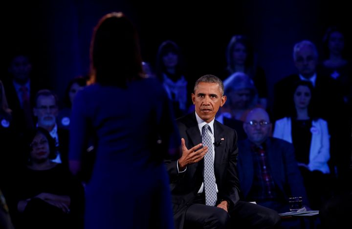 President Barack Obama answers a question at town hall at George Mason University on January 7, 2016 in Fairfax, Virginia. Hi