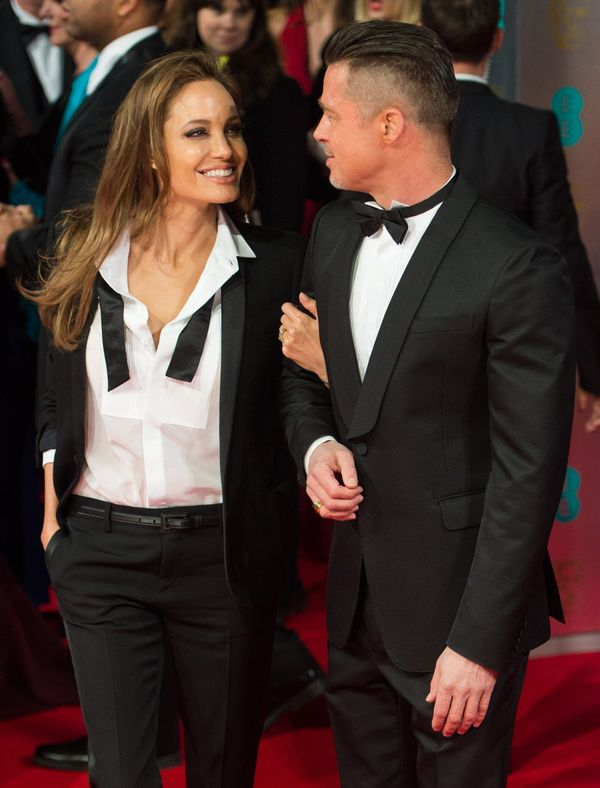LONDON, ENGLAND - FEBRUARY 16:   Brad Pitt and Angelina Jolie attend the EE British Academy Film Awards 2014 at The Royal Ope