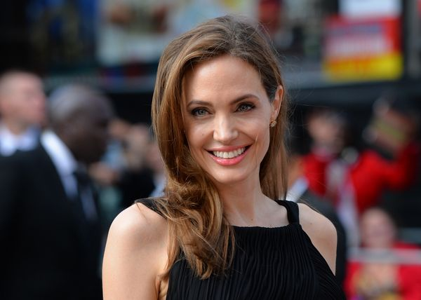 US actress and humanitarian campaigner Angelina Jolie poses as she arrives for the UK premiere of her US actor and fiance Bra