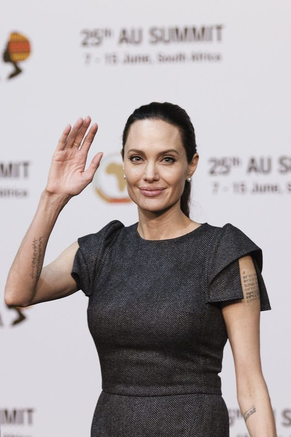 United States actress and UNHCR representative Angelina Jolie waves ahead of a panel on Conflict related gender violence on J