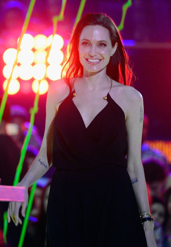 INGLEWOOD, CA - MARCH 28:  Actress Angelina Jolie walks to stage to accept award for Favorite Villain in 'Maleficent' at the