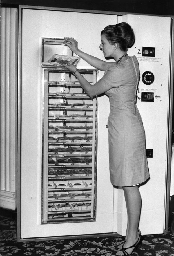 "Londoner Pauline Dawkins demonstrating how to use the new refrigerated vending machine called the ""5 Star Microdine Hot Meal"