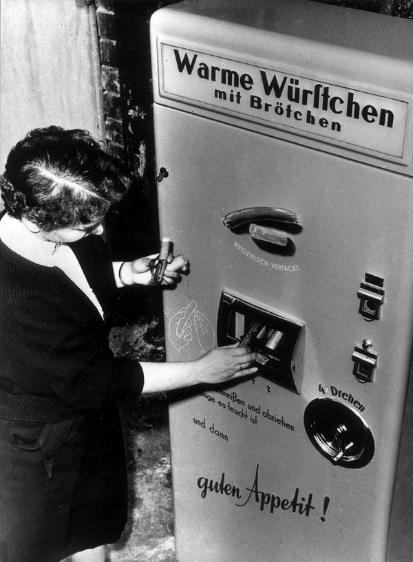 Vending machine selling hot sausages presented at the industries fair in Berlin, Germany, circa 1954.