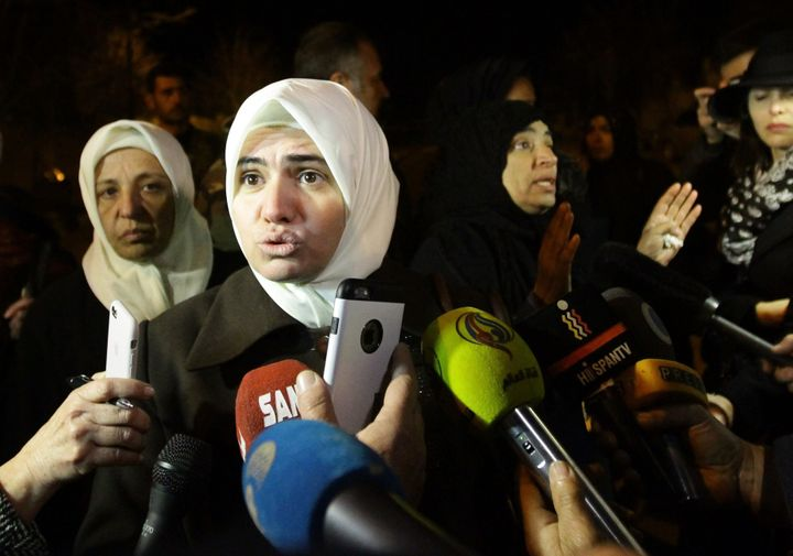 Syrian women speak to the press on the outskirts of the besieged rebel-held Syrian town of Madaya, on January 11, 2016, after