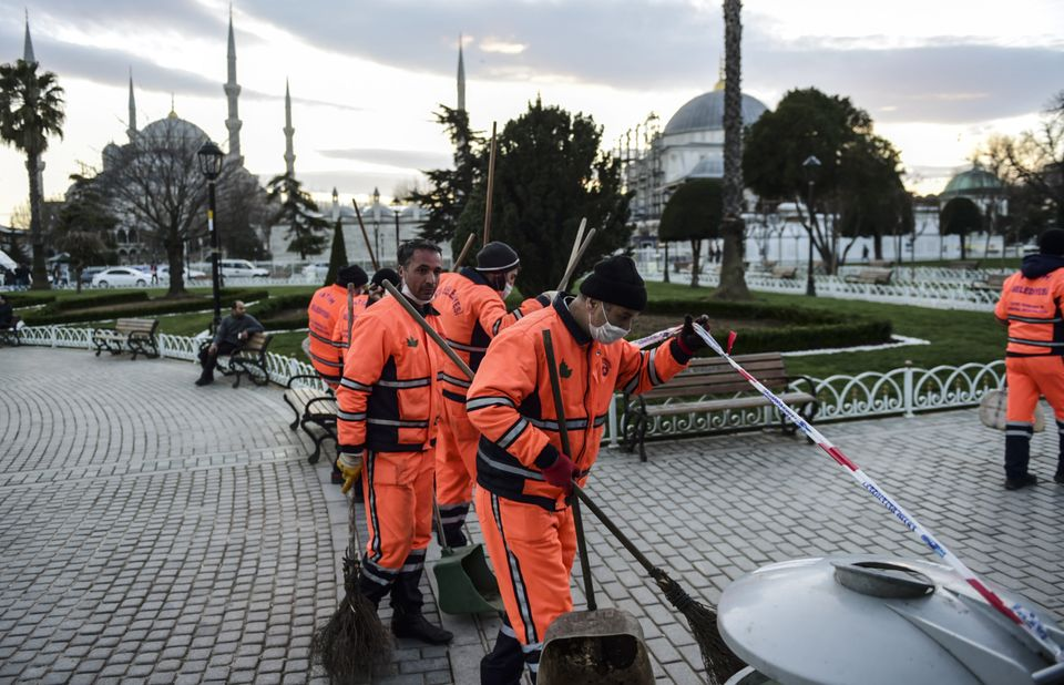 Workers clean out the site of a deadly bomb attack in popular tourist hub Sultanahmet in Istanbul, Turkey, on Jan. 12.