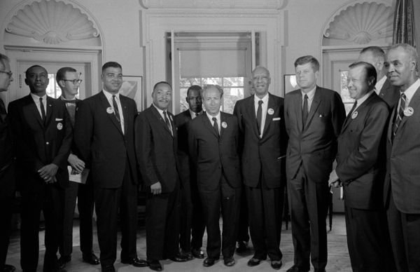 In this image, civil rights leaders meet with President John F. Kennedy in the oval office of the White House after the March