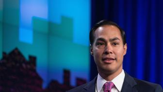US Housing and Urban Development (HUD) Secretary Julian Castro arrives to speak at the National Fair Housing Training and Policy Conference at the Housing and Urban Development Department in Washington, DC, on September 2, 2015.    AFP PHOTO/NICHOLAS KAMM        (Photo credit should read NICHOLAS KAMM/AFP/Getty Images)