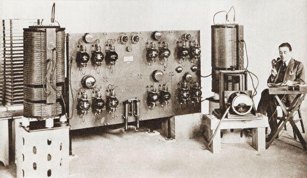 Radio announcer transmitting a news bulletin in 1920.