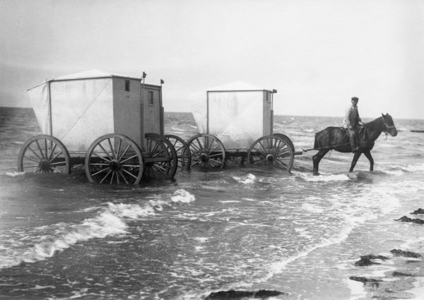 Bathing machines that were used for changing in and swimming from at aseaside resort at the North Sea coast in Germany&