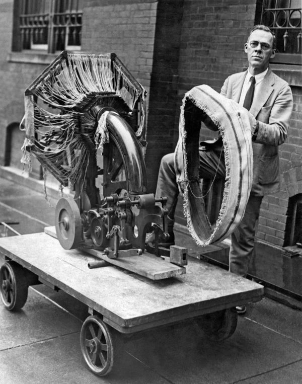A Smithsonian Institute official holding a portable tire-making device inWashington, D.C., on Aug. 21, 1925.