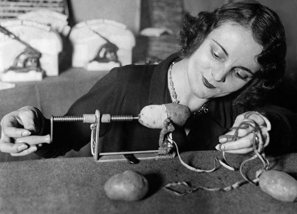 Woman usinga potato peeling machine in 1932.