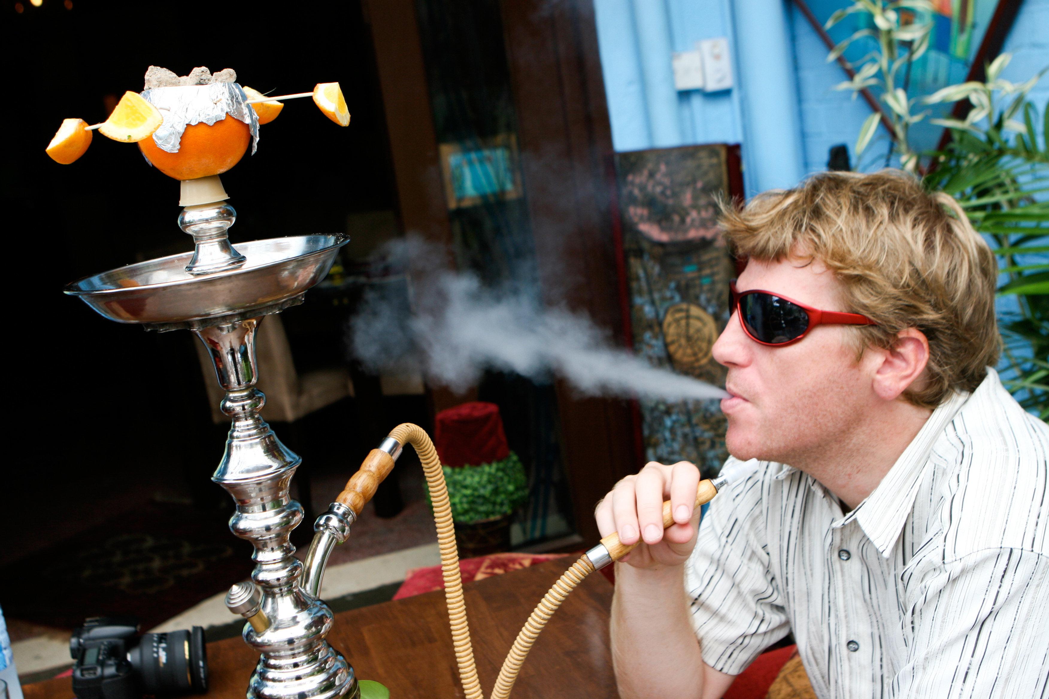 Man smoking a hookah.