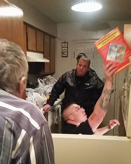 Officers with Tennessee's Mt. Pleasant Police Department are seen stocking an elderly man's kitchen.