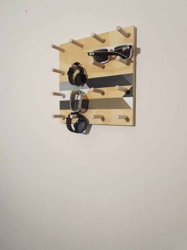 "Use the flexible pegs on this <strong><a href=""https://www.etsy.com/listing/254122551/wall-hooks-mens-valettie-rack-watch"">ha"