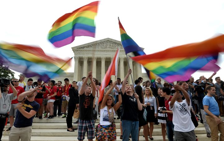 People celebrate outside the Supreme Court in Washington, DC in June, 2015, after its historic decision on gay marriage.