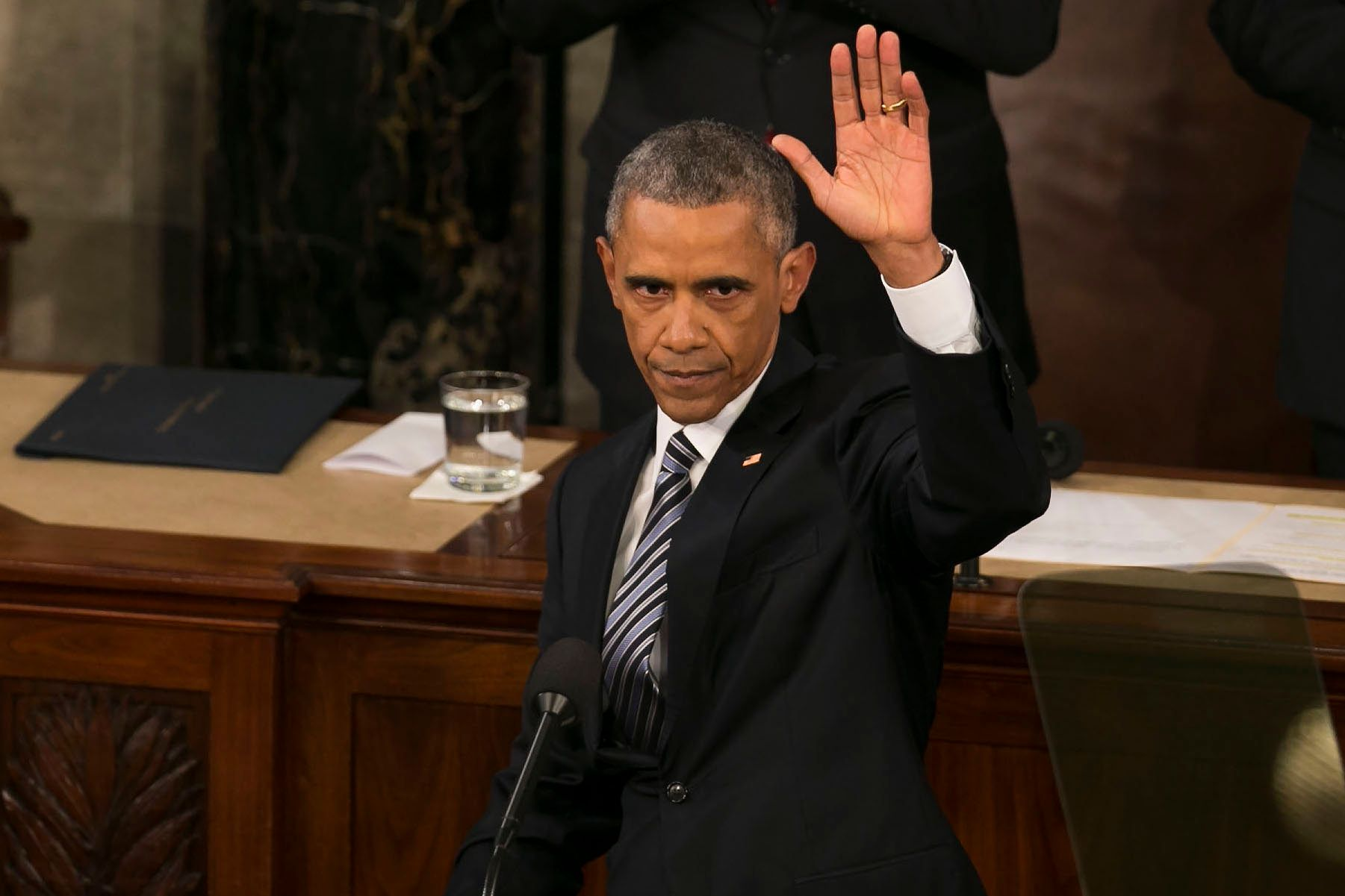 UNITED STATES - JANUARY 12 - President Barack Obama waves during his final State of the Union to a joint session of Congress in the House Chamber on Capitol Hill in Washington, Tuesday, Jan. 12, 2016. Behind him Vice President Joe Biden and House Speaker Paul Ryan listen. (Photo By Al Drago/CQ Roll Call)