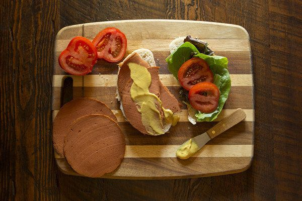 """A meatless bologna deli sandwich, """"made without the mystery."""""""