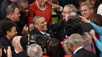 US President Barack Obama is greeted by members of Congress as he arrives to deliver the State of the Union address at the US Capitol in Washington, DC, on January 12, 2016. Obama used his final State of the Union address Tuesday, one of the last grandstand occasions of his presidency, to define his legacy and make the case for optimism amid an angst-ridden election race.  / AFP / NICHOLAS KAMM        (Photo credit should read NICHOLAS KAMM/AFP/Getty Images)