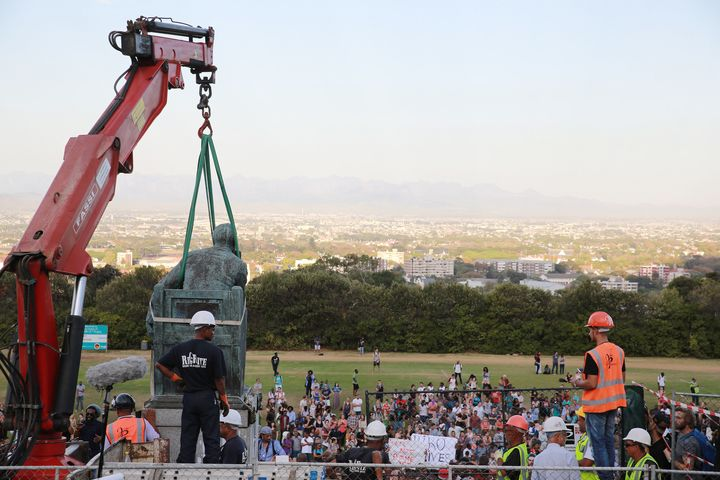 Students celebrate as the Cecil John Rhodes statue is removed at the University of Cape Town on April 9, 2015 in CapeTown, So