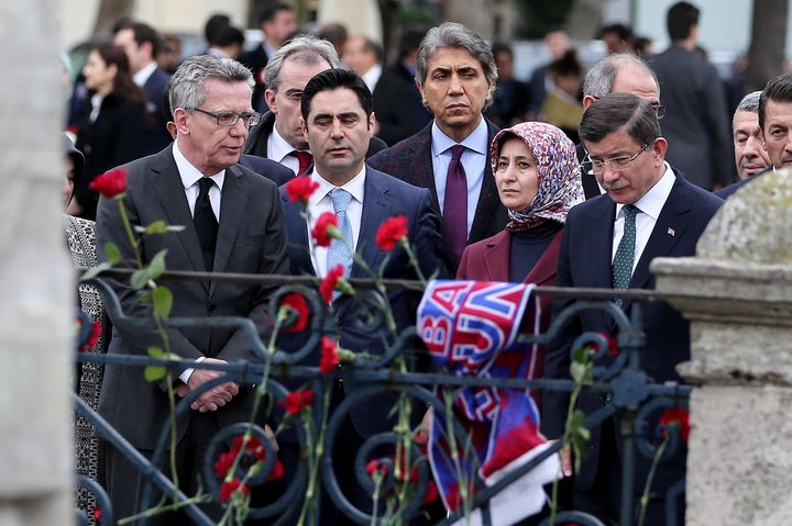 Turkish Prime Minister Davutoglu mourns at the location of a terror attack that killed at least 10 in Istanbul on Tuesday. Th