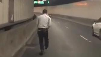Police say this 42-year-old man was fined for riding a children's push scooter through a busy Sydney tunnel on Tuesday.