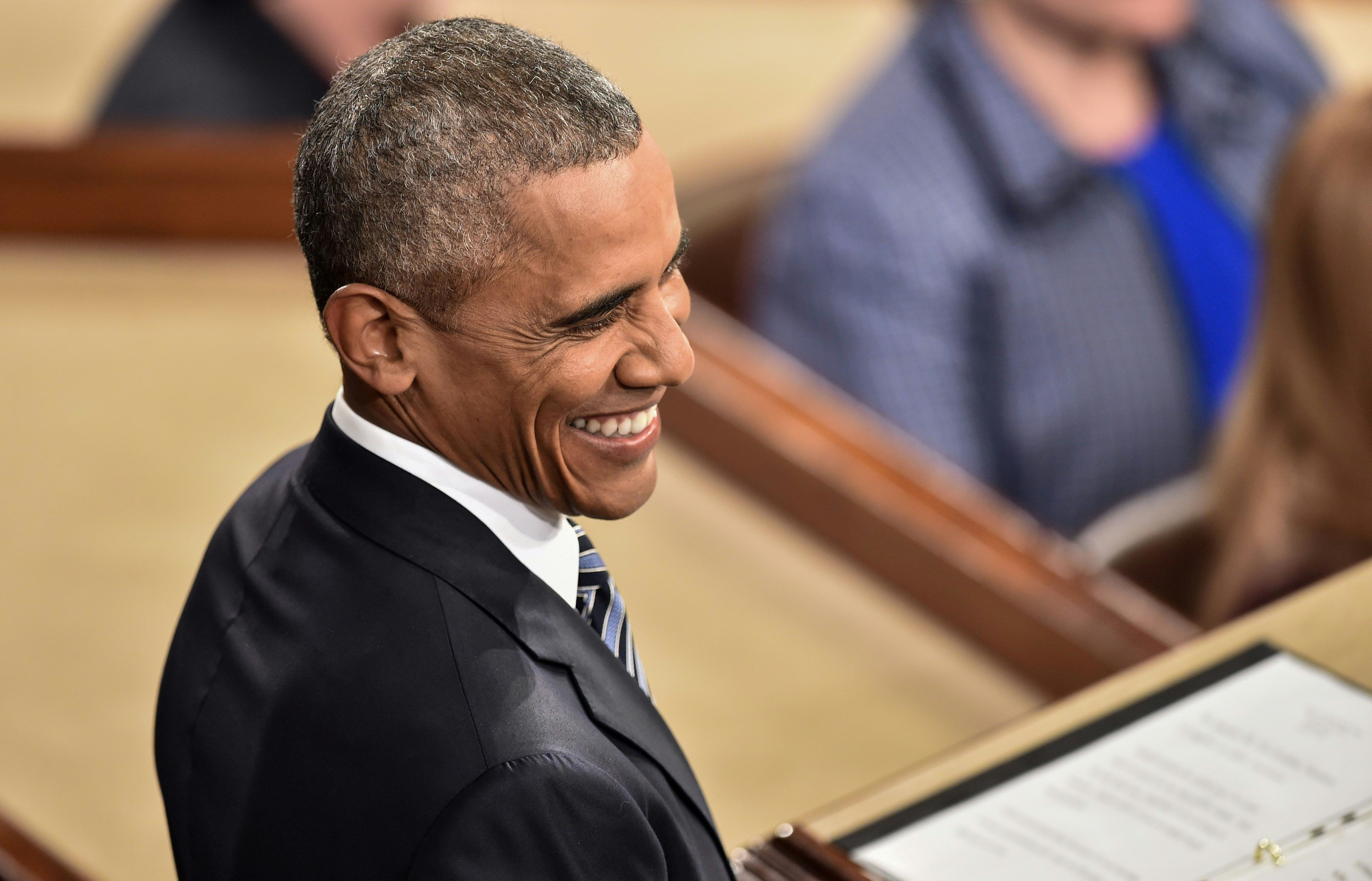 US President Barack Obama smiles as he arrives to deliver the State of the Union address at the US Capitol in Washington, DC, on January 12, 2016.  Obama gives his final State of the Union address, perhaps the last opportunity of his presidency to sway a national audience and frame the 2016 election.    / AFP / NICHOLAS KAMM        (Photo credit should read NICHOLAS KAMM/AFP/Getty Images)