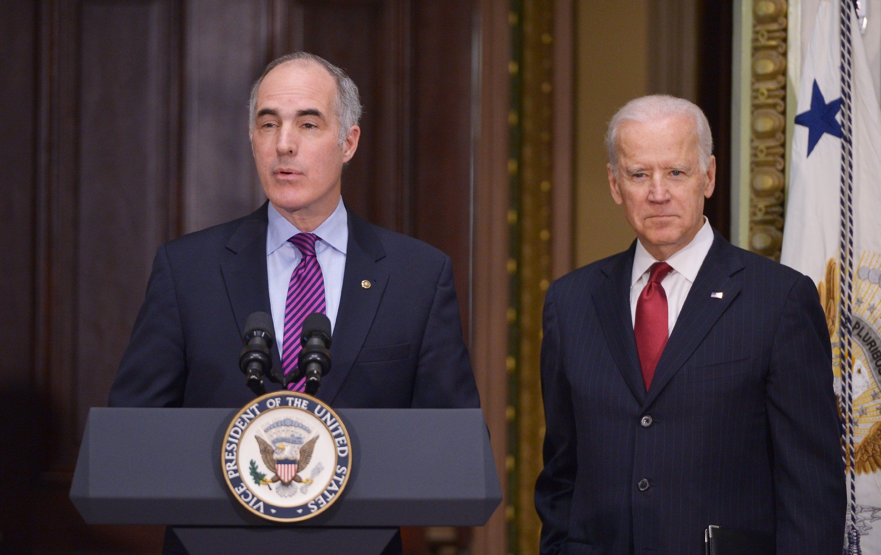 Senator Bob Casey, D-PA, introduces US Vice President Joe Biden during an event with members of Congress to highlight the benefits of the ABLE (Achieving Better Life Expectancy) Act in the Eisenhower Executive Office Building, next to the White House on February 10, 2015 in Washington, DC. AFP P HOTO/MANDEL NGAN        (Photo credit should read MANDEL NGAN/AFP/Getty Images)
