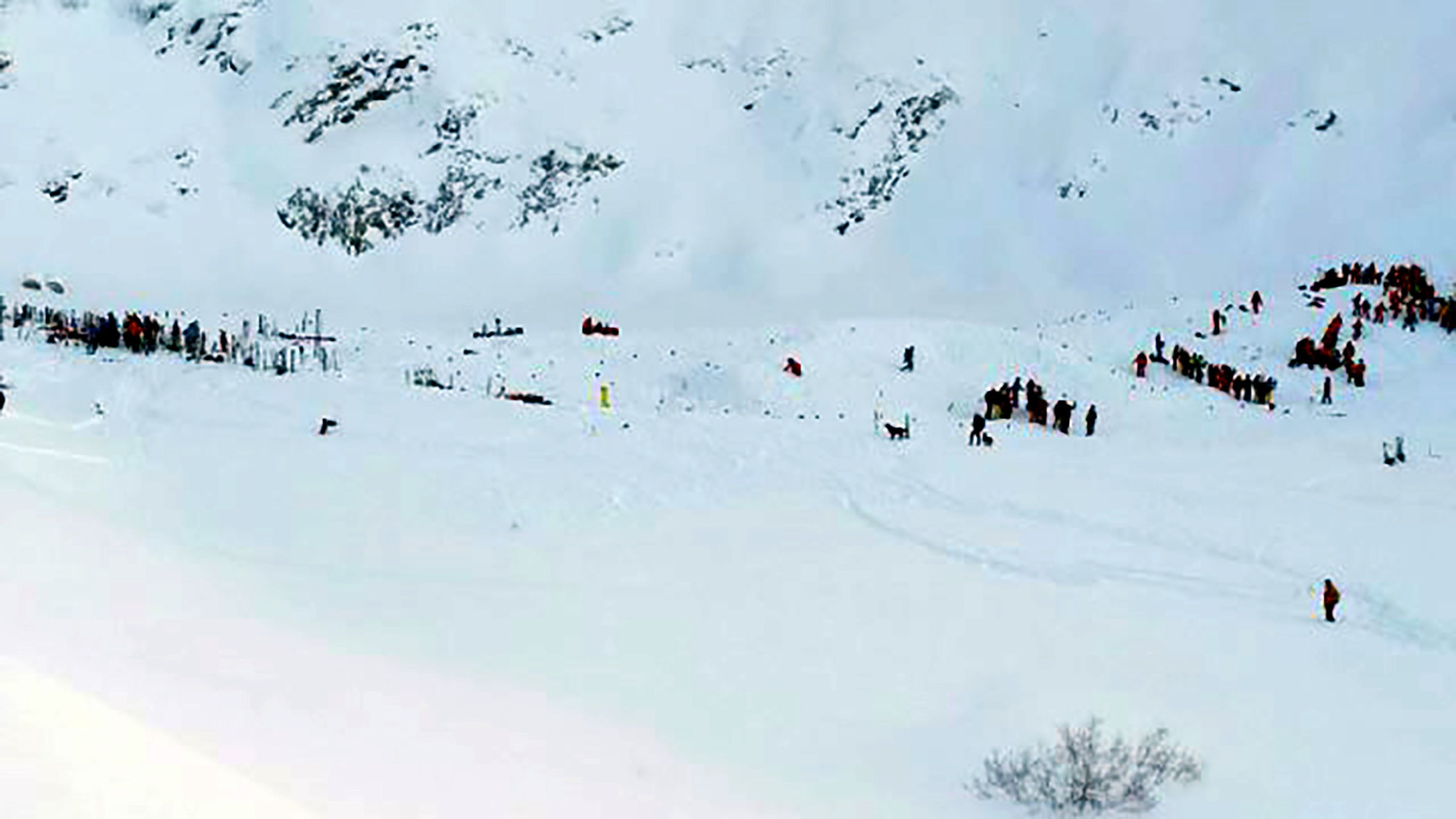 Rescuing teams gather for search and rescue operations on a piste at the avalanche site after skiers, including a group on a school outing, were swept away in the Les Deux Alpes resort in The French Alps on January 13, 2016. Two teenagers and a Ukrainian man were killed when an avalanche swept away skiers in the French Alps, including a group on a school outing, local officials said today. The avalanche hit a piste at the Deux-Alpes resort in eastern France that was still closed to the public, engulfing a group of nine French school children and their teacher from the city of Lyon, according to police sources. / AFP / STRINGER        (Photo credit should read STRINGER/AFP/Getty Images)