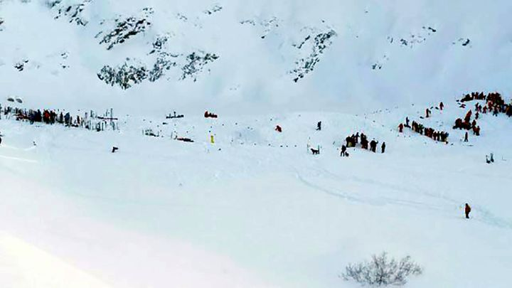 At least three people are reported killed in an avalanche in the mountain range. Teams gather for search and rescue oper
