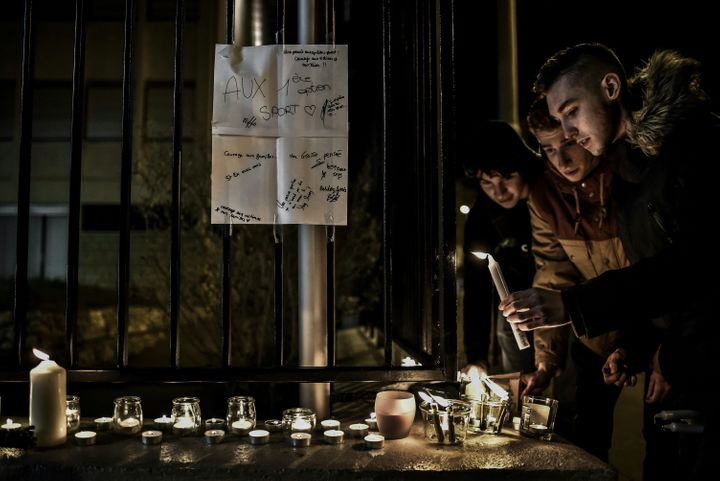Two of the victims were teenagers. Students light candles outside the Saint-Exupery high school in Lyon, whose students and t