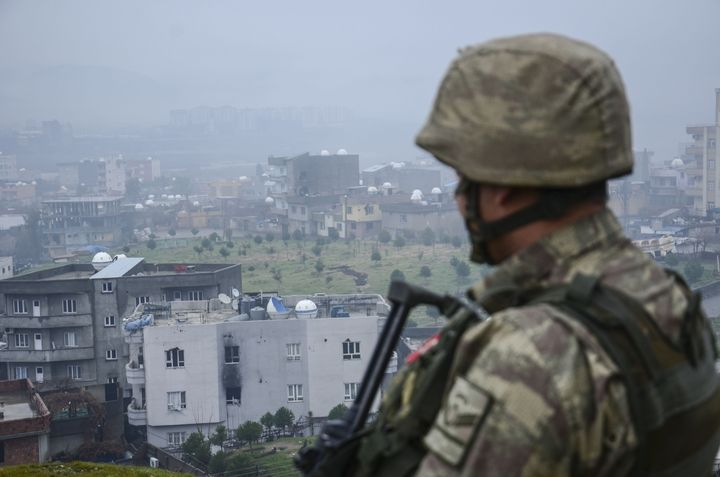 A soldier looks out over Cizre district after the government carried out an anti-terror campaign against the PKK there.