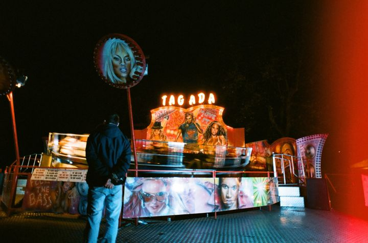 The spinning ride, identified as the Tagada, only gives riders a bar to hold onto as they're thrown around.
