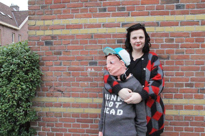 Marieke Voorsluijs, hugs her yarn son.