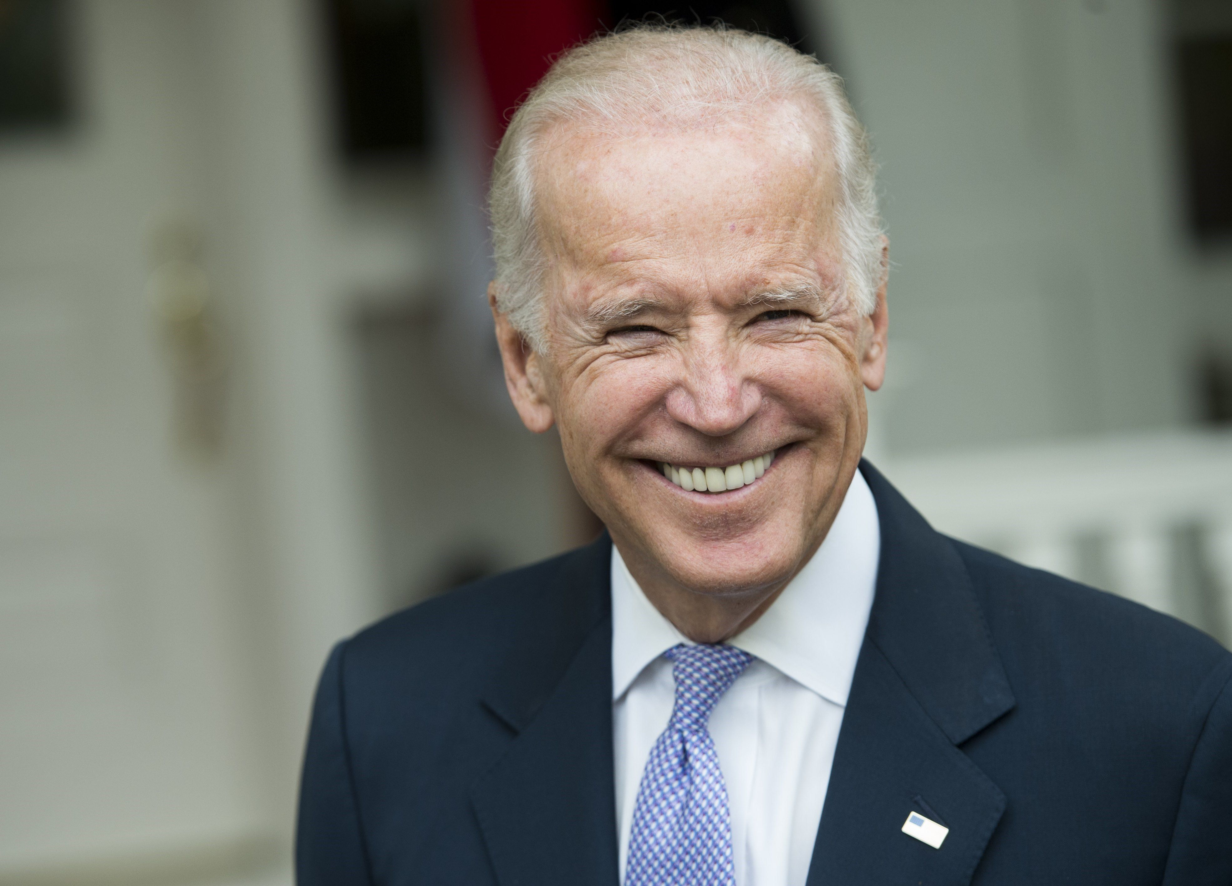 US Vice President Joe Biden laughs as he speaks to the media about the tentative budget deal between the White House and Congress at the Naval Observatory in Washington, DC, October 27, 2015. AFP PHOTO / SAUL LOEB        (Photo credit should read SAUL LOEB/AFP/Getty Images)