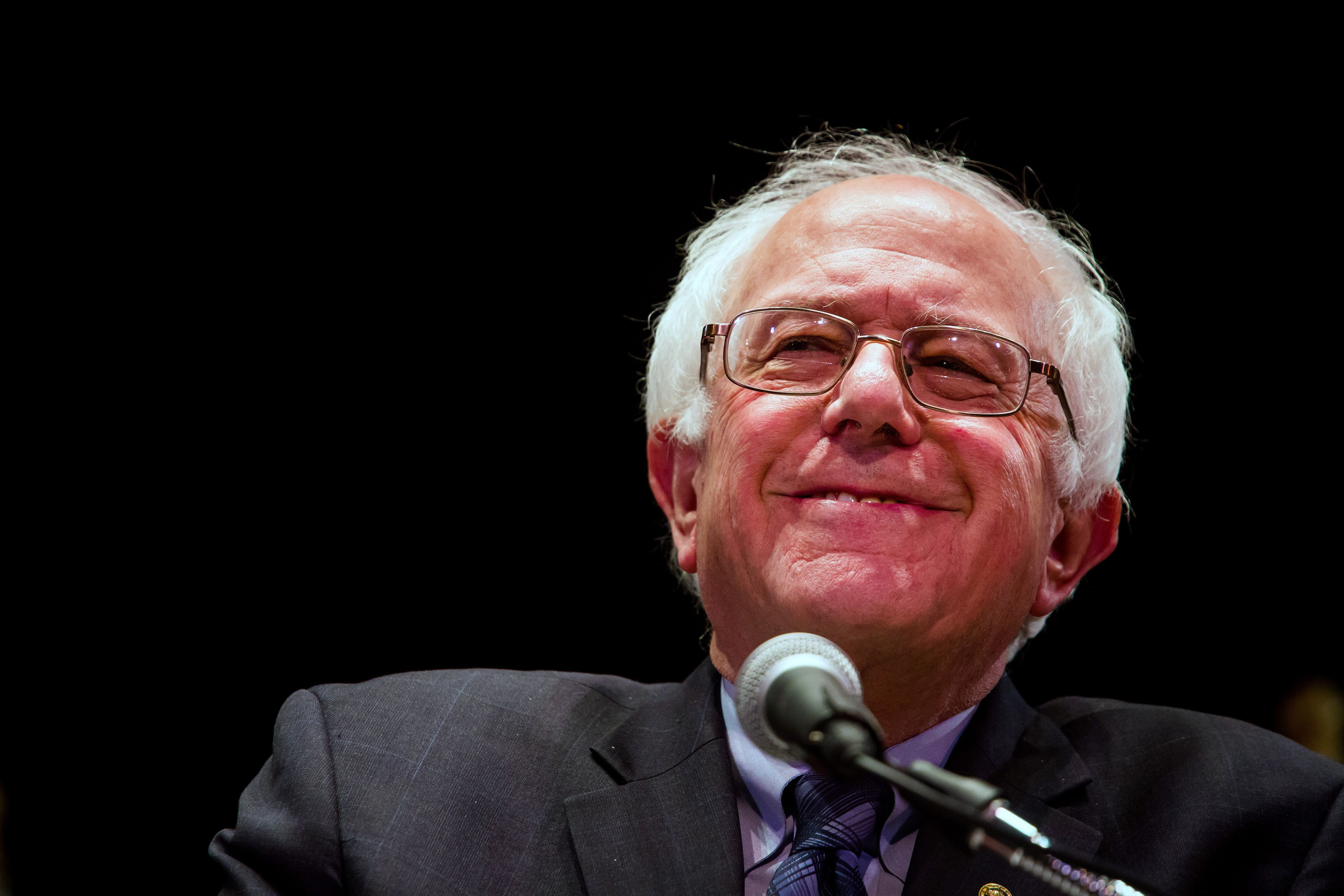 Senator Bernie Sanders, an independent from Vermont and 2016 Democratic presidential candidate, smiles during a speech in New York, U.S., on Tuesday, Jan. 5, 2016. Sanders lambasted the power the biggest lenders have and the Wall Street and corporate greed he said is destroying the nations fabric. Photographer: Michael Nagle/Bloomberg via Getty Images