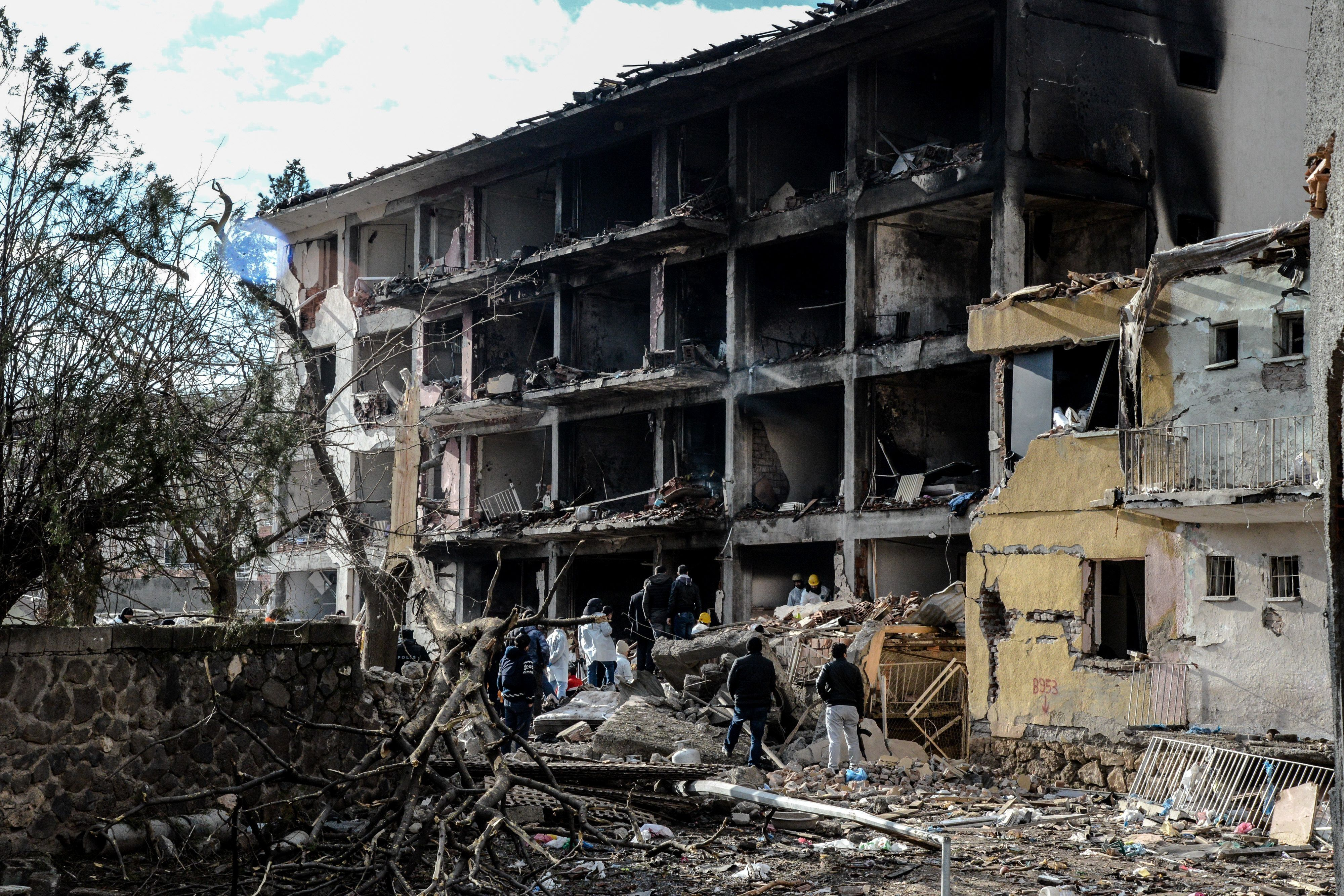 Turkish police search through the wreckage of a blast damaged building on January 14, 2016 in Diyarbakir. Six people died and 39 others were wounded in a car bomb attack blamed on Kurdish rebels that ripped through a police station and an adjacent housing complex for officers and their families in southeastern Turkey, security forces said Thursday, updating an earlier toll of five. / AFP / ILYAS AKENGIN        (Photo credit should read ILYAS AKENGIN/AFP/Getty Images)