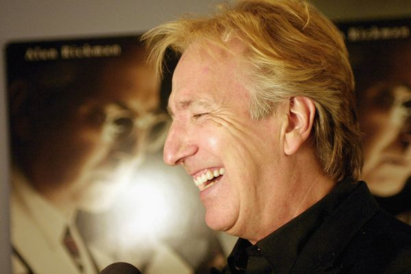 "Alan Rickman laughs during an interview at the premiere of HBO's ""Something The Lord Made,"" May 17, 2004, in New York. ("