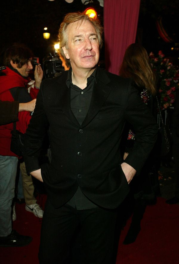 "Alan Rickman during the ""Love Actually"" premiere in Paris, France in 2003. (Photo by Tony Barson Archive/WireImage)"
