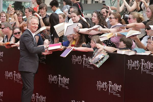 "Actor Alan Rickman and fans attend the premiere of ""Harry Potter and the Deathly Hallows: Part 2"" at Avery Fisher Hall, Linco"
