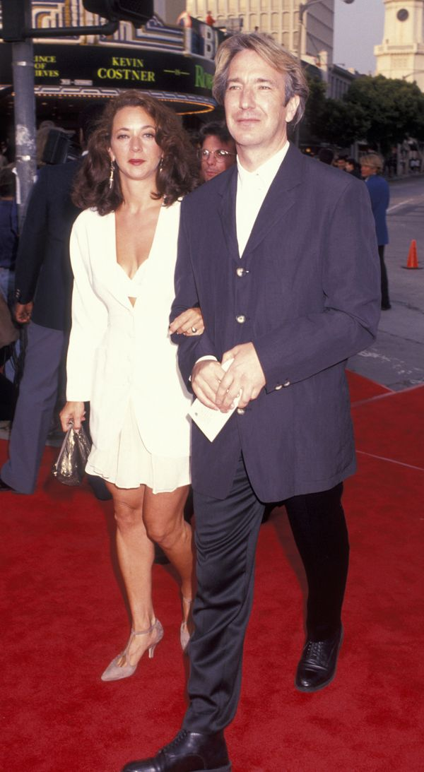"Actor Alan Rickman and date attending the premiere of ""Robin Hood-Prince of Thieves"" on June 10, 1991, at Mann Village T"