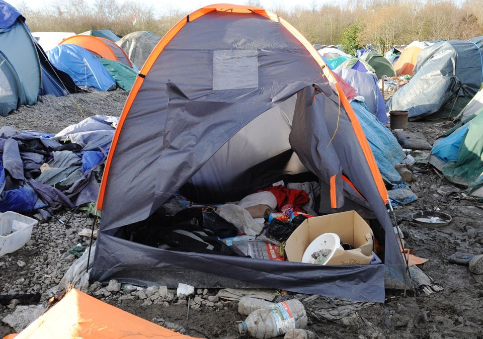 A refugee tent, filled with white bread, antiseptic, and