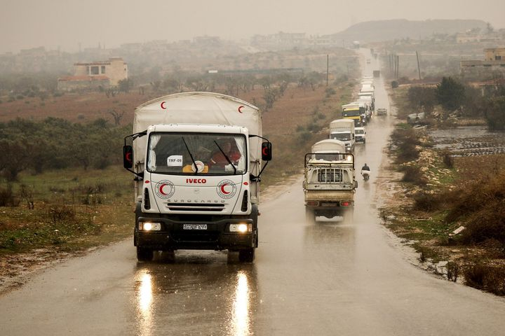 A Syrian Red Crescent convoy carrying humanitarian aid drives on a road in the town of Foua in Idlb, Syria, on Jan.