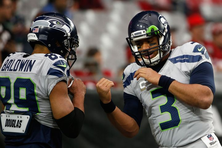 Russell Wilson (right) has tossed 15 touchdown passes to Doug Baldwin this season. Baldwin's 15 TDs are the most by any recei
