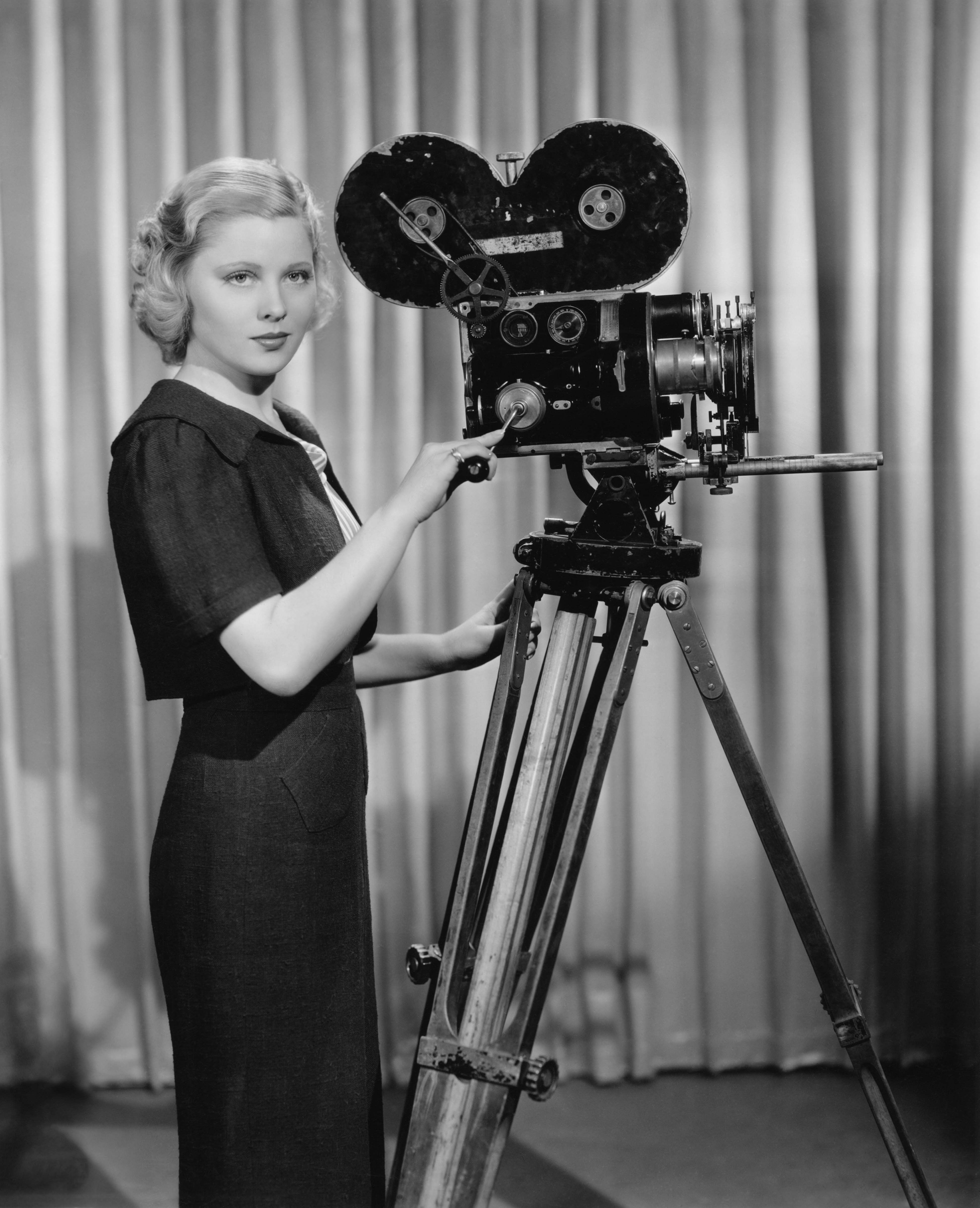 Portrait of a woman operating a movie camera