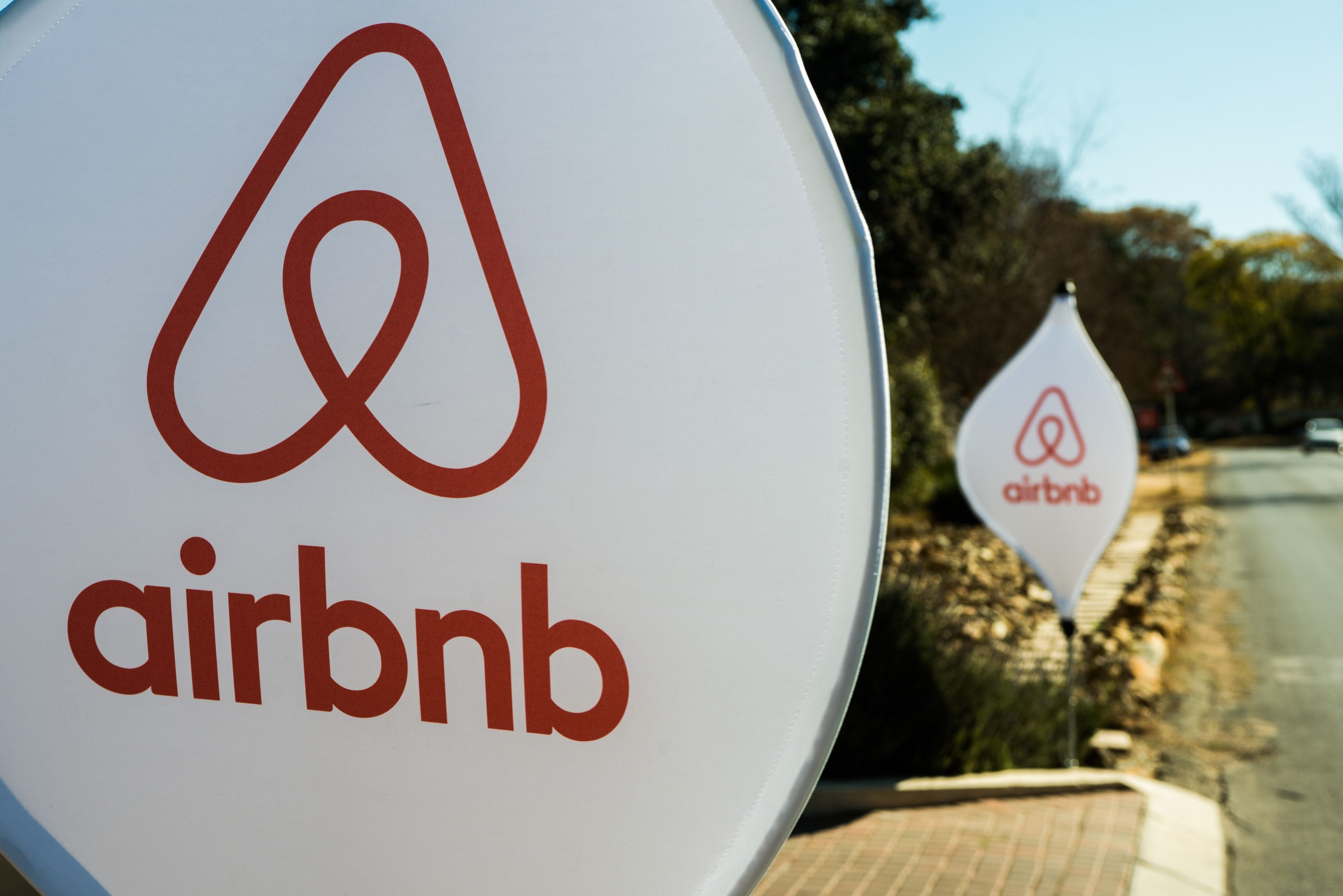 The logos of Airbnb Inc. sit on banners displayed outside a media event in Johannesburg, South Africa, on Monday, July 27, 2015. Airbnb is hoping to spread its unique brand of hospitality throughout Africa. Photographer: Waldo Swiegers/Bloomberg via Getty Images