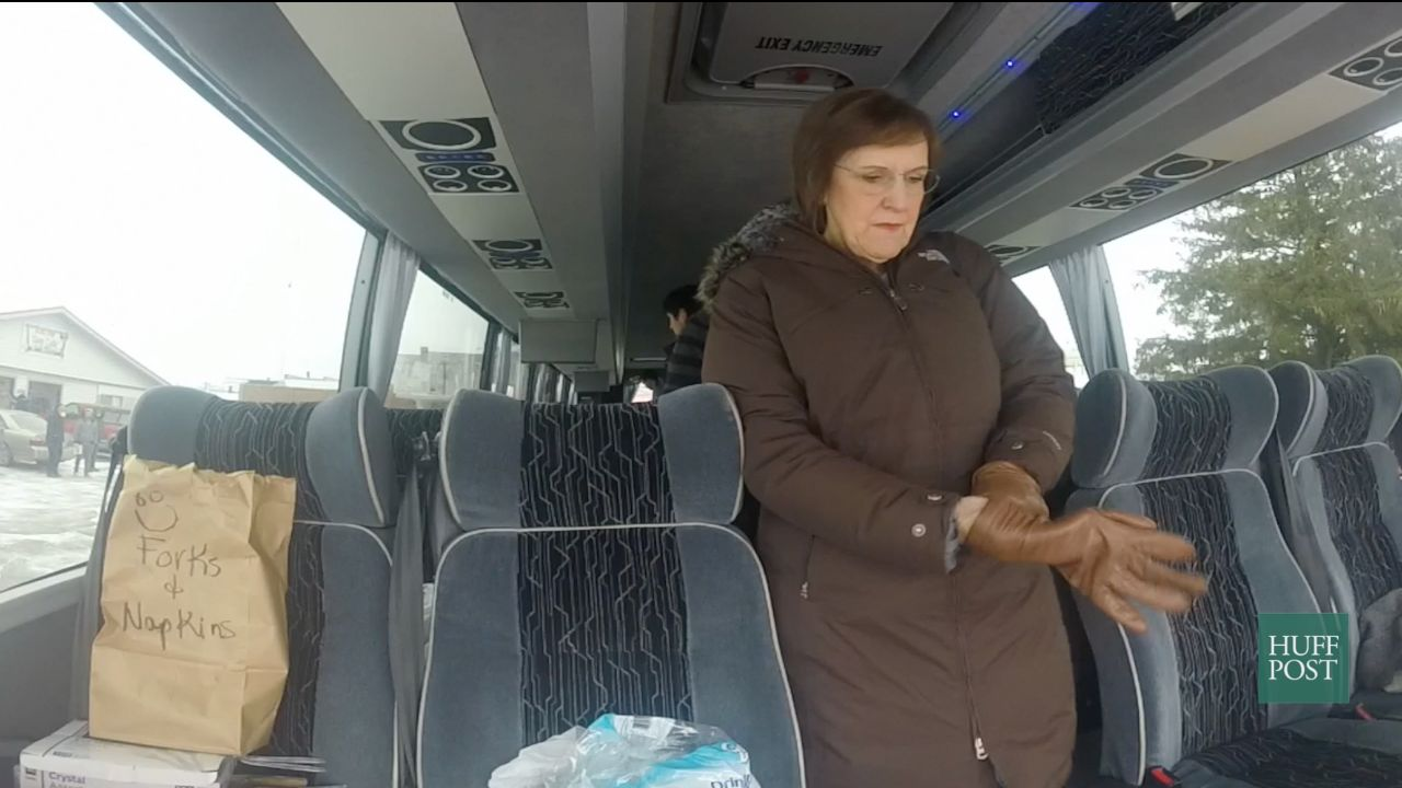Karen Tumulty, a national correspondent with The Washington Post, bundles up before getting off the media bus to cover a Ted